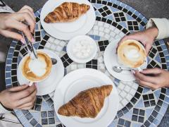 two people having croissants and coffee