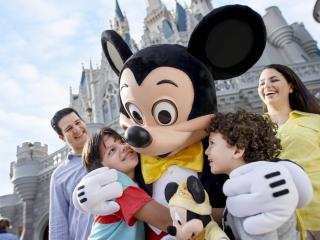 Mickey Mouse hugging children at Walt Disney World